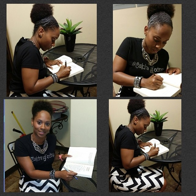 """Manor signing book copies. Check out that """"Catching Feelings"""" Tee!"""